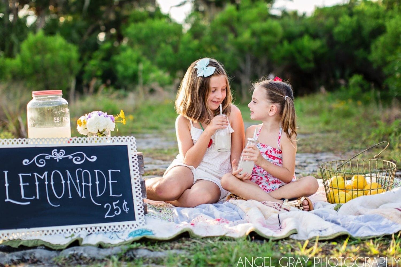 sisters with lemonade